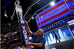 Workers prepare the Wells Fargo Center in Philadelphia for the four-day Democratic National Convention that opens today.