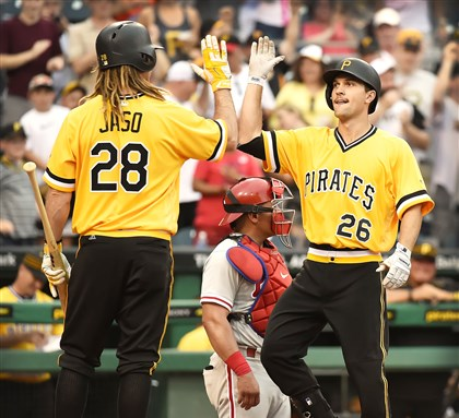 The Pirates' Adam Frazier is greeted at home by John Jaso after hitting a a solo homer to put the Pirates ahead of the Phillies 5-4 at PNC Park.