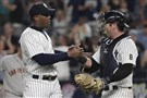 Relief pitcher Aroldis Chapman, left, shakes hands with catcher Austin Romine after a save earlier this season.