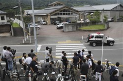 Journalists gather in front of Tsukui Yamayuri-en, a facility for the handicapped where a number of people were killed and dozens injured in a knife attack in Sagamihara, outside Tokyo today.