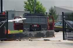 A Dump truck driver crashes his vehicle through the security gate of the FBI's offices on the South Side in July 2016.