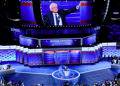 Sanders stands with Clinton at DNC convention