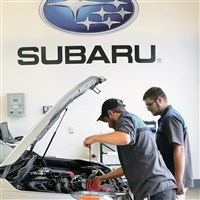 Louis Veitz, left, and Austin Griffith work on a 2014 Forester at the Kenny Ross Subaru in North Huntingdon.