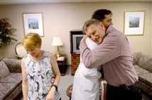 With his wife, Dianna, at his side, Mark Iobst, 63, hugs Robert Moraca Tuesday at Allegheny General Hospital. Dr. Moraca was the surgeon who led the team in saving Mr. Iobst from an uncommon, life-threatening heart condition.
