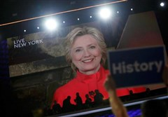 Democratic presidential nominee Hillary Clinton addresses the Democratic National Convention via a live video feed from New York during the second night at the Democratic National Convention in Philadelphia Tuesday night.