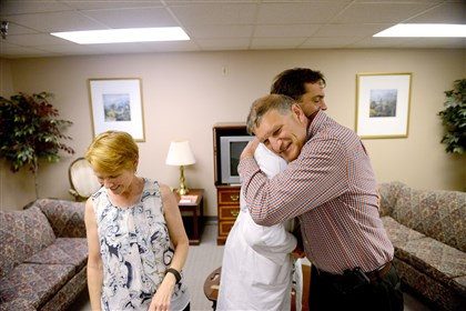 With his wife, Dianna, at his side, Mark Iobst, 63, hugs Robert Moraca on Tuesday at Allegheny General Hospital. Dr. Moraca was the surgeon who led the team in saving Mr. Iobst from an uncommon, life-threatening heart condition.