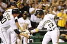 Andrew McCutchen is congratulated by his teammates after hitting a three-run homer against the Mariners Wednesday night at PNC Park.