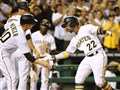 Andrew McCutchen is congratulated by his teammates after hitting a three run homer against the Mariners Wednesday night at PNC Park.