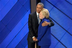 Hillary Clinton hugs President Obama on stage after he addressed the delegation during Day 3 of the Democratic National Convention at Wells Fargo Center in Philadelphia.