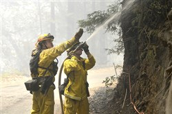 Firefighters extinguish hotspots while fighting the Soberanes Fire in Palo Colorado Canyon on the northern Big Sur Coast on Tuesday in Big Sur, Calif.