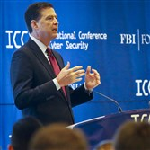 James Comey, director of the Federal Bureau of Investigation, speaks as he delivers the keynote address at the International Conference on Cyber Security on Wednesday at Fordham University in New York.