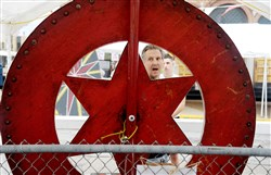 Tom Kilt of McKees Rocks runs the Chuck-a-Luck game at the St. Mary's Ukrainian Festival in McKees Rocks on Thursday.