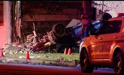 One person was killed when a vehicle struck a utility pole and building before flipping over on Frankstown Avenue in the East Hills.
