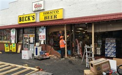 A vehicle crashed into the Beck's beer distributor building overnight in Washington, Pa.