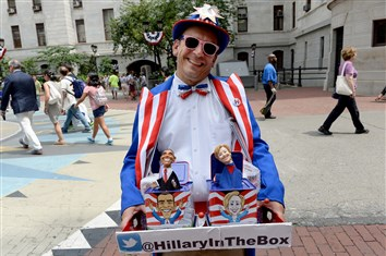 "David Manzo of San Jose displays his ""Hillary In The Box"" at City Hall Thursday in Philadelphia."
