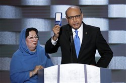 Constitution-waver: Khizr Khan, right, and his wife Ghazala at the Democratic National Convention on Thursday.