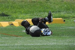 Le'Veon Bell stretches during the first day of training camp in Latrobe on July 29, 2016.