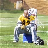 Steelers linebacker James Harrison takes a break at an early workout of training camp at Saint Vincent College in Latrobe.