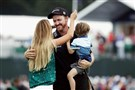 Jimmy Walker celebrates with his wife Erin and son Beckett after making par on the 18th hole to win the PGA Championship Sunday at Baltusrol Golf Club in Springfield, New Jersey.