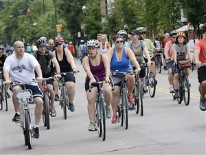 Bicycle riders roll down Western Ave on the North Side during Open Streets Pittsburgh.