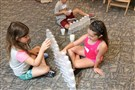 Upper St. Clair fourth-graders Bailey Wells and Katerina Spanos take part in the Cup Challenge as part of this summer's STEAM Investigates engineering camp.