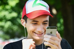 Austin Rodriguez, 16, of Brackenridge, plays Pokemon Go near his home . Austin, who has high functioning autism, said the game has helped him to improve his social skills, problem solving and decision making.