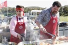 "Slippery Rock native Nathan Barnhouse , left and Red Team chef Terry Mueller toil in the fields for this week's ""MasterChef"" challenge. Fox/Greg Gayne"
