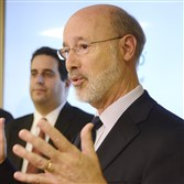 Gov. Tom Wolf and, in background, Ted Dallas, secretary of the Department of Human Services in Pennsylvania