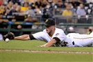 Tony Watson tries to field a bunt attempt Aug. 5 against the Reds at PNC Park.