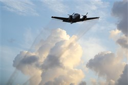 A plane sprays pesticide over the Wynwood neighborhood of Miami last week in the hope of controlling and reducing the number of mosquitoes that may cause the Zika virus.