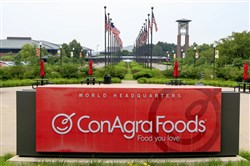 In this June 30, 2015, file photo, flags fly over ConAgra Foods world headquarters in Omaha, Neb.