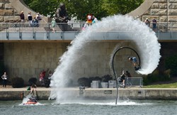 A Water Jet Pack performer does a stunt Friday during the Three Rivers Regatta on the Allegheny River near the North Shore.