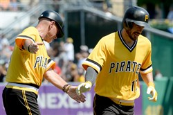 Pirates third base coach Rick Sofield congratulates Matt Joyce after Joyce hit a home run in August.