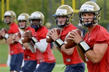 Nate Peterman, right, will lead Pitt's quarterbacks. Who will see time behind him should he get hurt remains an open question.