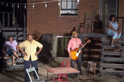 "Teri Bridgett, Kevin Brown, Jonathan Berry and Ty Barrow, in Pittsburgh Playwrights Theatre Company's ""Seven Guitars,"" which was performed in its original setting, outside the childhood home of Hill District playwright August Wilson."