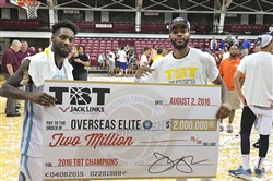 Former Schenley teammates DeAndre Kane, left, and D.J. Kennedy celebrate winning The Basketball Tournament with Overseas Elite last season. They repeated their championship with this year with an 86-83 win against Team Challenge ALS Thursday in Baltimore.