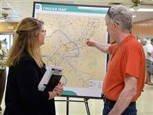 Diane Nulton of McCormick Taylor talks with Harry Thompson about where the new Mon-Fayette Expressway would go during a public meeting Tuesday. Mr. Thompson will not be affected by the new road.