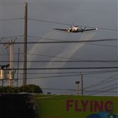 A plane sprays pesticide over the Wynwood neighborhood in the hope of controlling and reducing the number of mosquitoes, some of which may be capable of spreading the Zika virus, on Saturday in Miami.