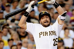 Francisco Cervelli reacts after getting hit by a pitch Tuesday against the Padres at PNC Park.