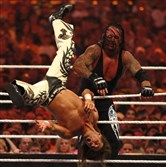 The Undertaker tosses Shawn Michaels in Michaels' last match, in 2010.