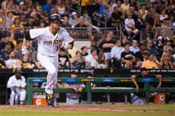 Pirates shortstop Jordy Mercer gets a hit Wednesday night.