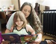 Jessica Neal reads to her daughter, Julianna, in their apartment in Washington County.