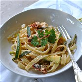 Sun-dried tomatoes add a kick to this speedy linguine and zucchini dish.