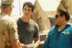 "Miles Teller and Jonah Hill, right, stumble along in ""War Dogs."""