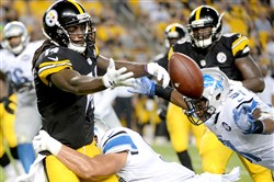Steelers receiver Sammie Coates fumbles against the Detroit Lions in the fourth quarter Friday night at Heinz Field.