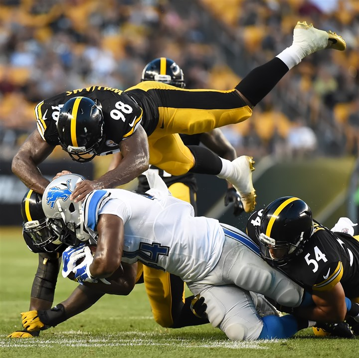 20160812pdSteelersSports10 Steelers linebacker Vince Williams (top) helps tackle Orson Charles of the Detroit Lions during an Aug. 12 preseason game at Heinz Field.