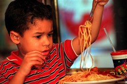 Nicholas Schilling tackles a plate of spaghetti and meatballs at the Spaghetti Warehouse in the Strip District in 1999.