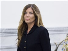 Attorney General Kathleen Kane walks down a hall at the Montgomery County Courthouse in Norristown, Pa.