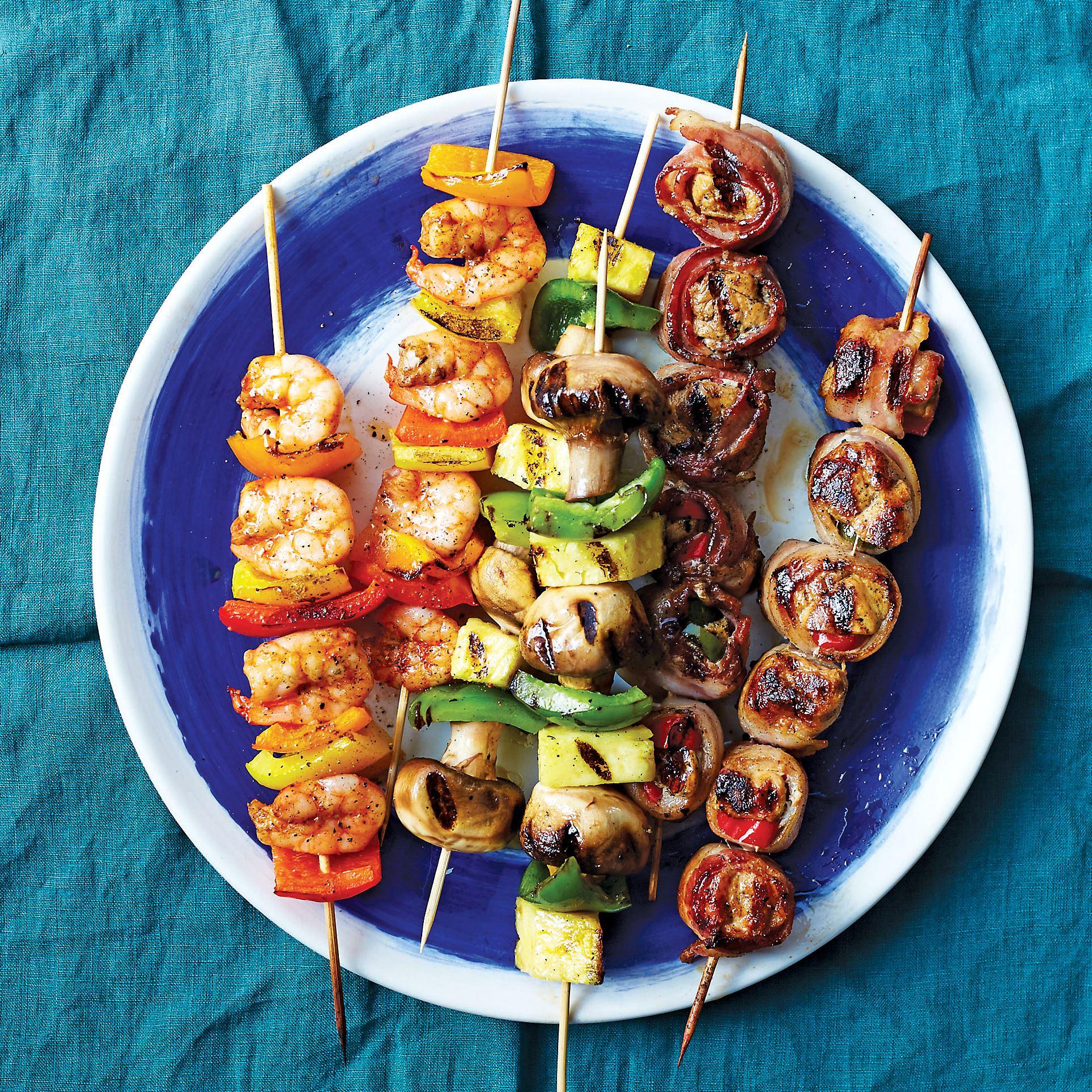 "Bacon_chicken_shrimp_skewers_hungry_fan Cajun Shrimp Skewers, vegetable skewers and Bacon-Wrapped Chicken Skewers from ""The Hungry Fan's Game Day Cookbook"" by Daina Falk."