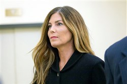 Pennsylvania Attorney General Kathleen Kane enters a courtroom at the Montgomery County Courthouse in August.